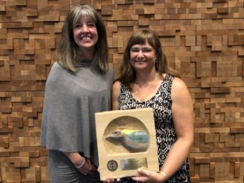 Nicola Koper (right), Professor accepted her 2017 PIF Public Awareness Award at the 27th International Ornithological Congress in Vancouver, BC. Also pictured is Wendy Easton, Canadian Wildlife Service.