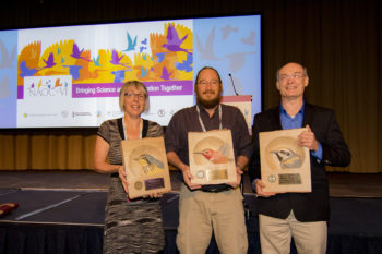 Judith Kennedy (left), Humberto Berlango, and Wayne Arendt (right) receiving their 2015  PIF Awards at the 2016 North American Ornithological Conference.